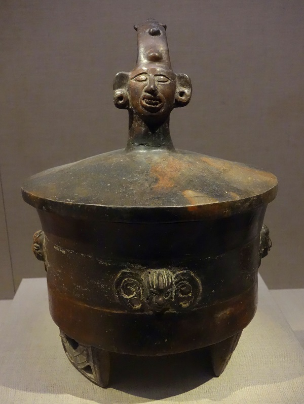 Art: a brown earthenware vessel for chocolate with a human head on top of the lid.