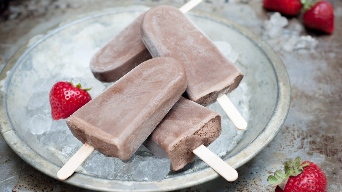 Plate of fudgesicles, with strawberries