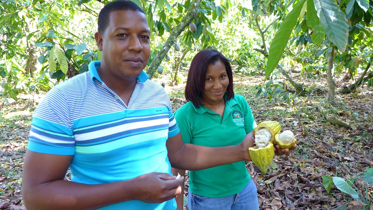 Cacao growers Ramon and Glenys with a cacao pod in the Dominican Republic.