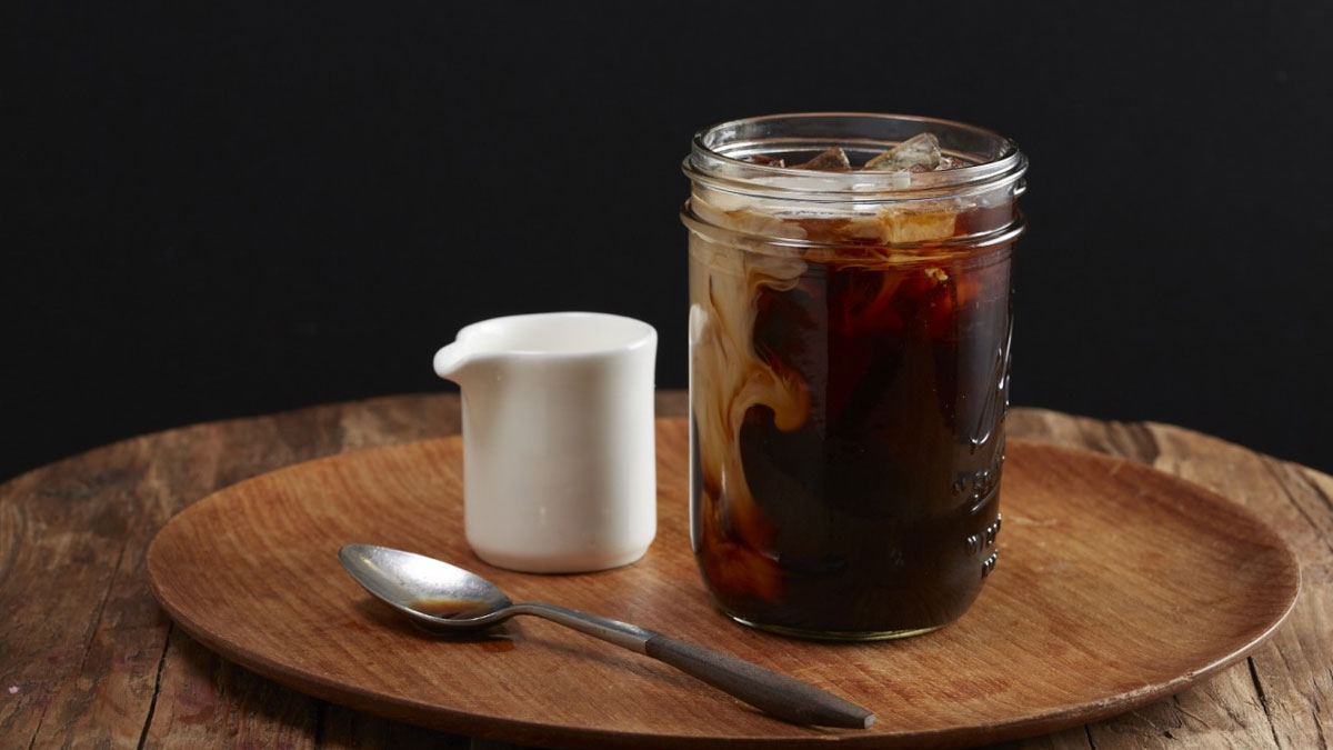 Coffee in a mason jar, with cream