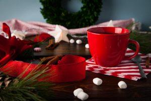 holiday scene of ribbon, coffee mug and marshmallows