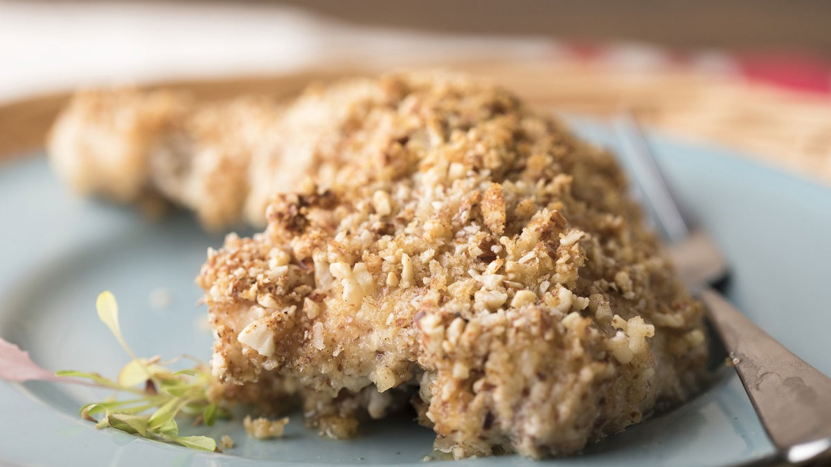 close up of crispy chicken with almonds