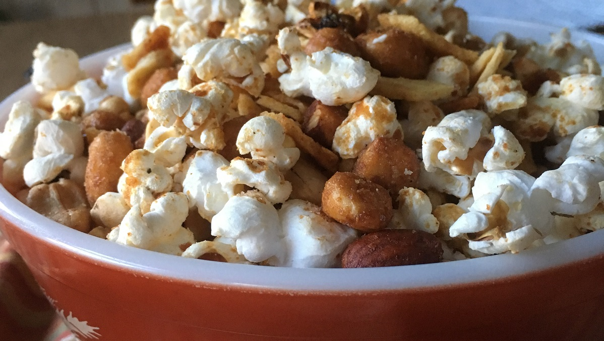 Popcorn and organic nuts in a spicy snack mix