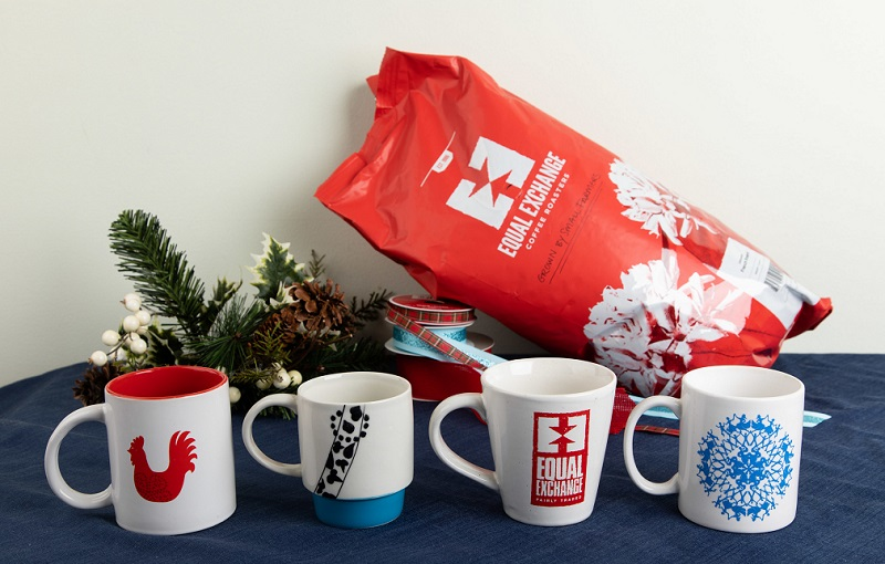 Mugs in a line in front of a bag of bulk coffee, ready for sustainable gifts
