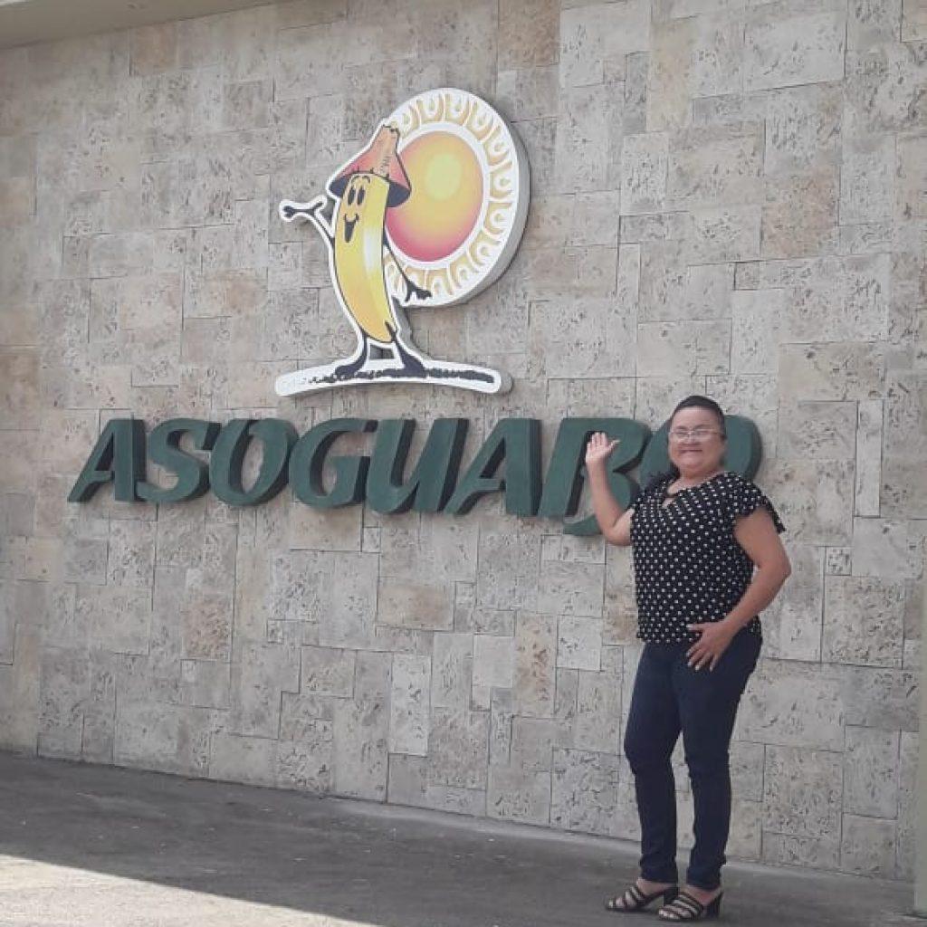 Caption: Cecilia poses outside the headquarters of farmer co-op AsoGuabo